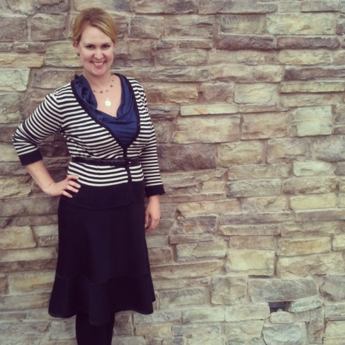 Black and white striped cardigan with navy ruffled top