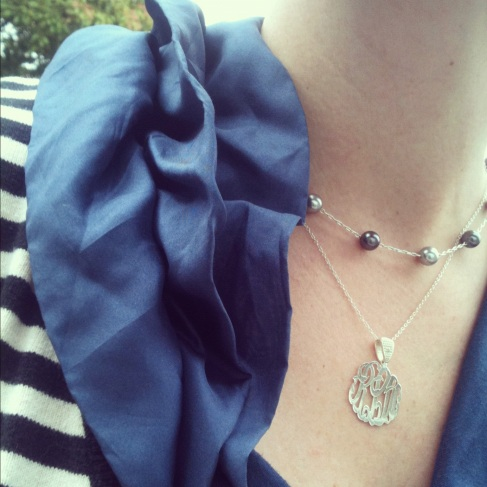 Navy ruffled top with monogram necklace