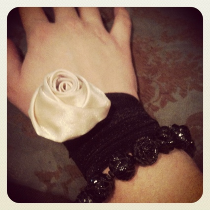 elastic headband with flower bobbypin with tarina Tarantino black rose bracelet