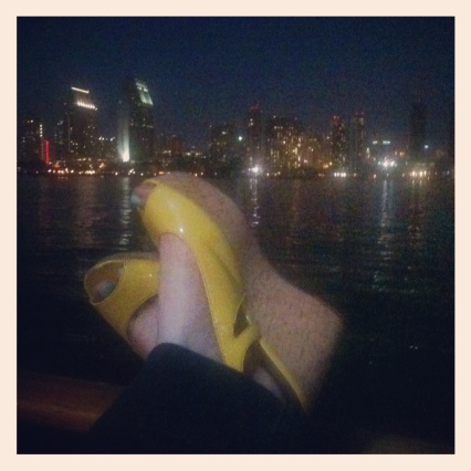 yellow patent wedges with san diego skyline at night