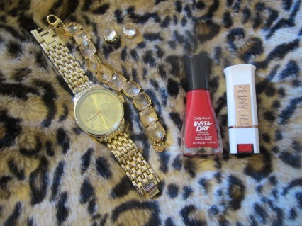 gold watch and earrings, red sally hansel nail polish, flower beauty lip color