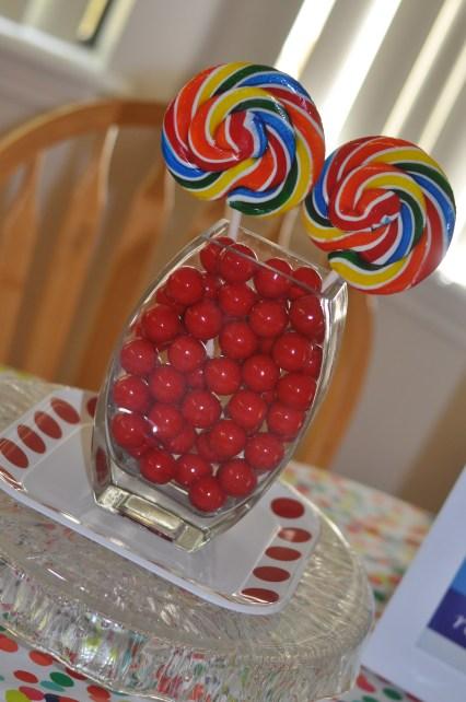 rainbow kids birthday party tablescape lollipops