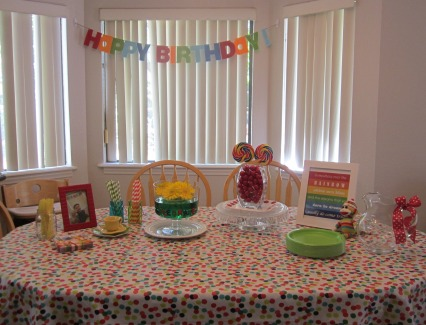 rainbow kids birthday party table setting polka dots
